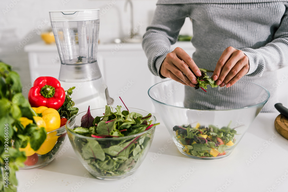 Fototapety, obrazy: cropped view of woman preparing salad in kitchen