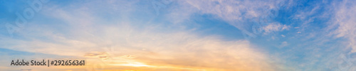plakat Panorama of Dramatic vibrant color with beautiful cloud of sunrise and sunset. Panoramic image.