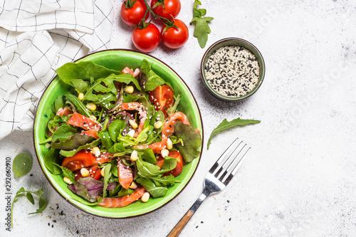 Salmon salad on white top view.