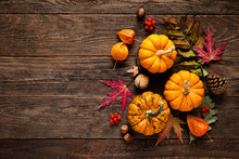 Autumn Decorative Pumpkins With Fall Leaves On Wooden Background. Thanksgiving Or Halloween Holiday, Harvest Concept. Top View, Copy Space. Greeting Card