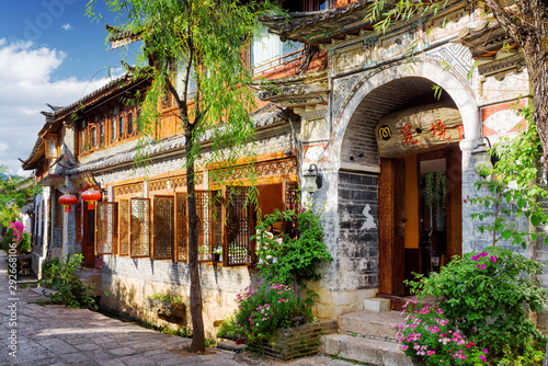 Traditional oriental Chinese house on a cozy street in Lijiang Canvas Print