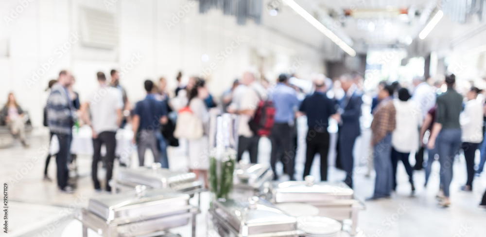 Fototapeta Blured image of businesspeople at coffee break at conference meeting. Business and entrepreneurship.