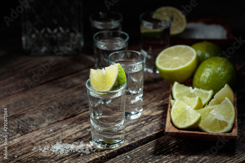 Fototapeta  Tequila with  salt and lime on a old wooden background.