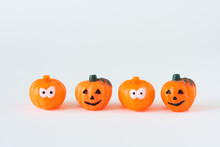 Four Pumpkins On White Background.