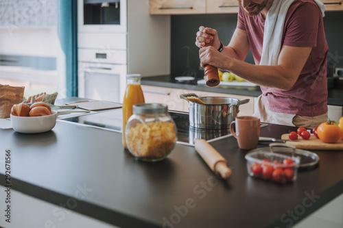 Fototapeta Cook preparing an Italian dinner at his kitchen obraz