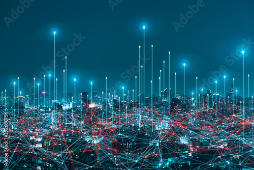 Fotografía  network digital hologram and internet of things on city background