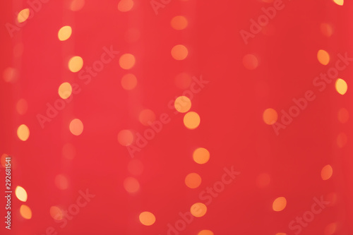 Abstract blurred shiny bokeh lights red background
