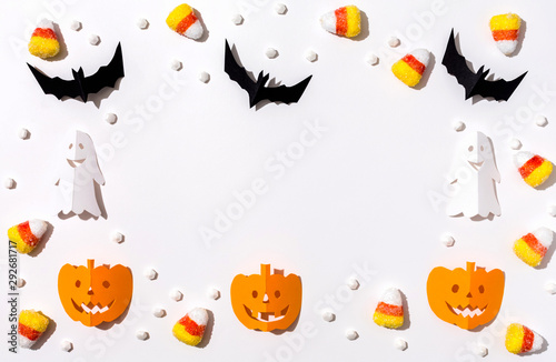 Vászonkép Halloween theme with paper craft decorations on a white background