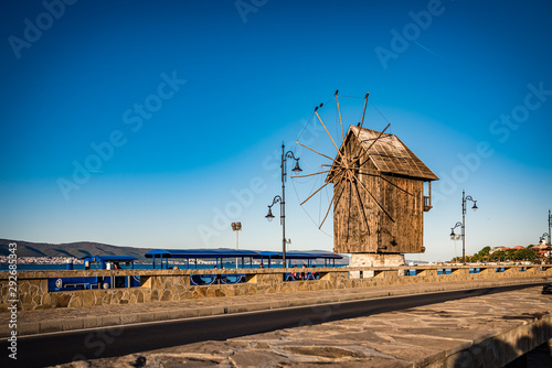 Poster Mills Old windmill in the morning ancient town of Nesebar in Bulgaria.