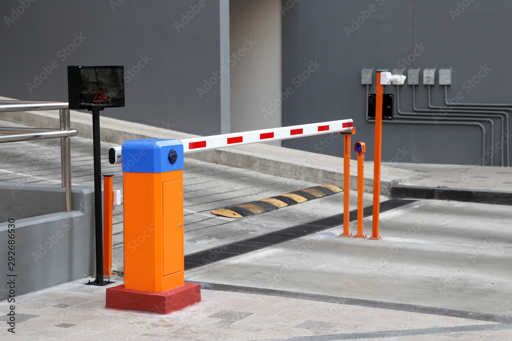 Fototapeta Automatic barrier gate with RFID Card dispenser system for car parking.