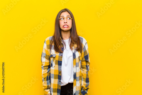 Fotografía  young  pretty woman looking worried, stressed, anxious and scared, panicking and