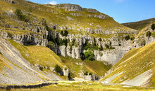 The Breathtaking View As The Walker Approaches The Limestone Cliffs At Gordale Scar In The Yorkshire Dales