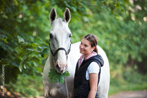 Canvas Pretty young teenage girl with her favorite gray horse