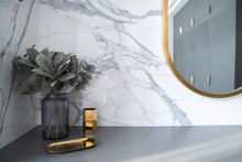 Bedroom Working Corner Decorated With Hexagon Gold Stainless Vase And Artificial Plant In A  Glass Vase On Gray Spray-painted  Working Table With Natural Marble Wall In The Background /apartment Inter