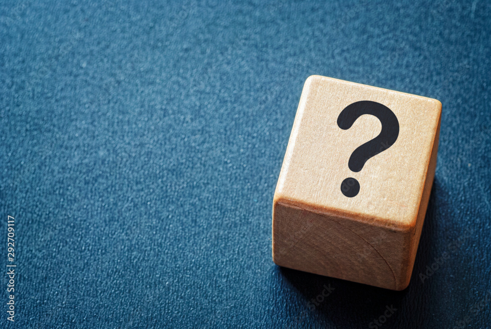 Fototapeta Wooden toy cube with a question mark
