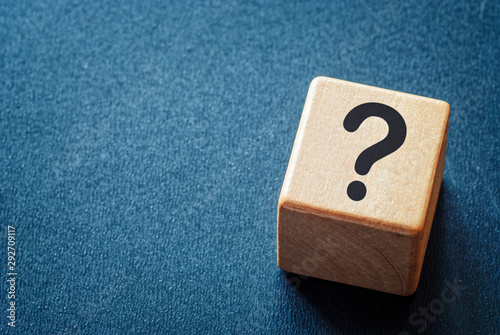 Fototapeta Wooden toy cube with a question mark obraz