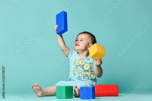 Fototapeta little boy child toddler playing with block toys obraz