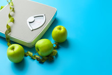 Scales, Apples And Measuring Tape On Color Background. Weight Loss Concept
