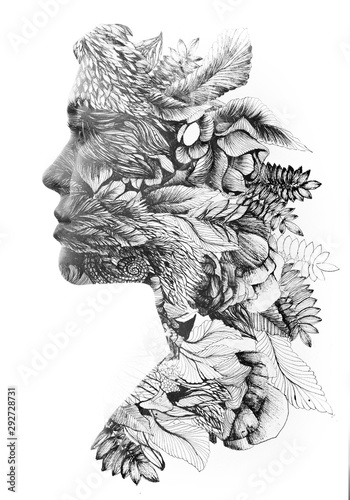 Paintography. Double exposure profile of a young natural beauty, with face and hair combined with hand drawn leaves and flowers dissolving into the background, black and white