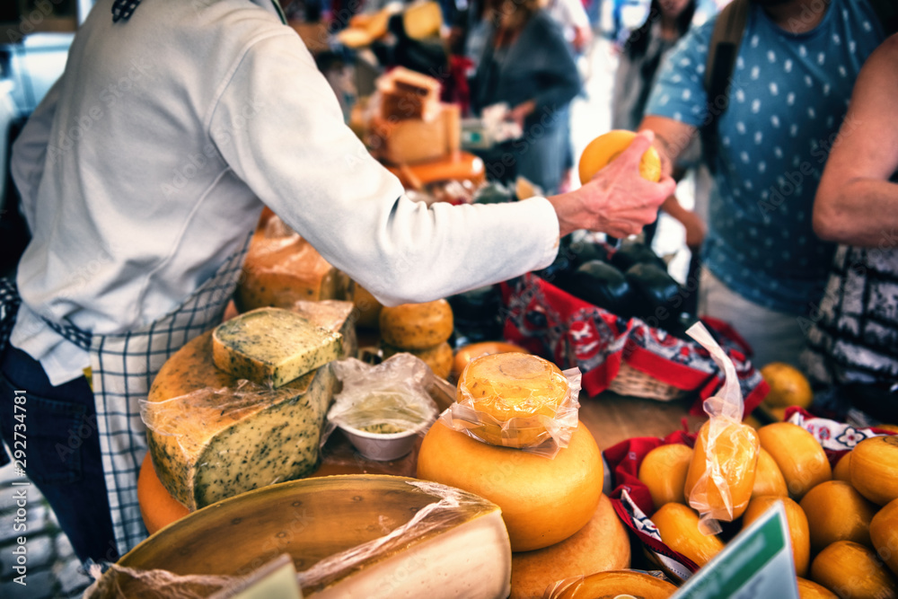 Fototapeta Selection of Dutch cheese at farmers traditional market