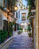 Fototapeta Uliczki - A picturesque and narrow street in Marbella old town, province of Malaga, Andalusia, Spain.
