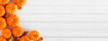 Autumn Pumpkin And Leaf Side Border Banner Over A Rustic White Wood Background With Copy Space