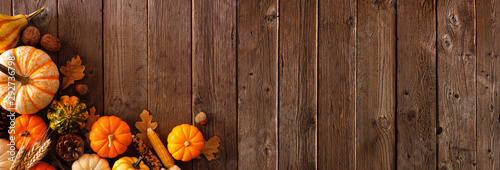 Autumn corner border banner of pumpkins, gourds and fall decor on a rustic wood background with copy space - 292736798