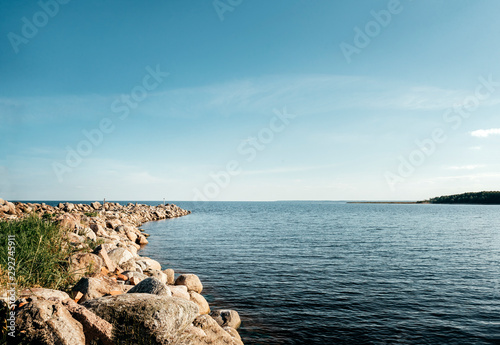 Valokuva  lake Ladoga shore in summer and autumn Sunny day, landscape, Russia