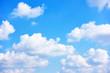 Leinwandbild Motiv Blue sky with white cumulus clouds