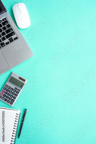 Vertical Top view office table desk. Workspace with calculator, pen ,laptop , note on the pastel green background.Copy Space for text,Empty Blank to word.Business Finance,Education Technology Concept. - 292750583