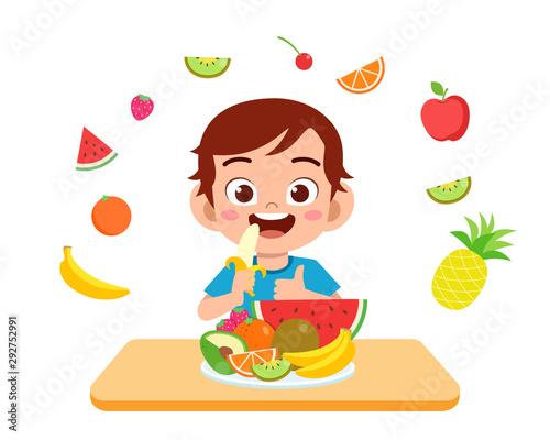 Fototapeta cute happy kid eat salad vegetable fruits obraz