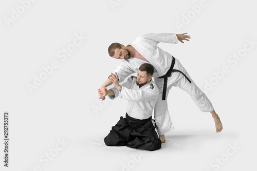 Canvas Print Two caucasian men are practicing aikido on the tatami (isolation path included)