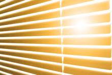 Sun Illuminates Room Or Office Through Gap On Wooden Venetian Blinds On Hot Sunny Day