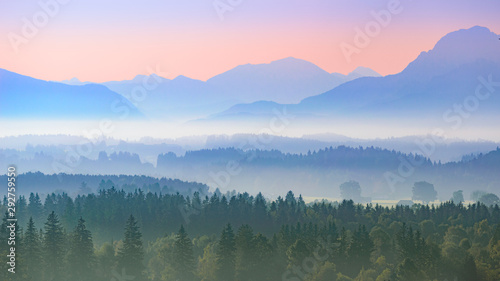 Poster Kaki Aerial panoramic landscape of Alpine foggy foothills with morning sunrise over mountains