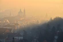 Winter Morning In The Mala Strana District - Historical Part Of Prague, Czech Republic. St. Nicholas Church. Sunrise. Fog. View From The Strahov Monastery.