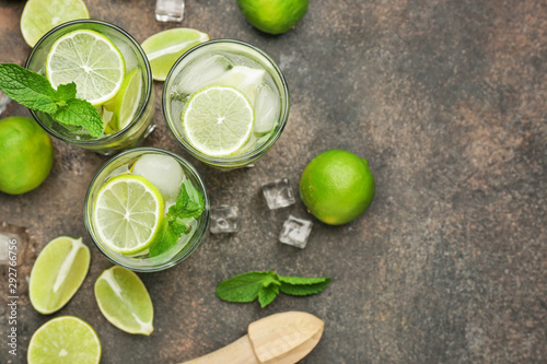 Glasses of fresh mojito on grey background Wallpaper Mural