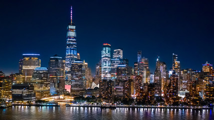 Panel Szklany Miasto Nocą Aerial view of Lower Manhattan skyline by in night in New York City
