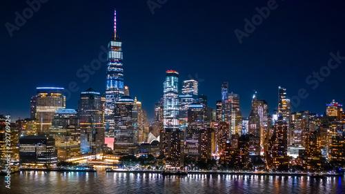 Fototapeta Aerial view of Lower Manhattan skyline by in night in New York City obraz