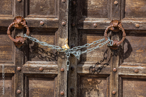 Old wooden door in Tuscany, Italy, chain locked Wallpaper Mural