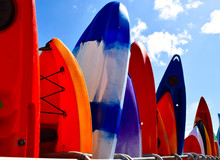 Row Of Kayaks In Lyme Regis, U...