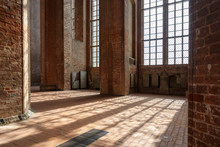 Sunlight Shines Through The High Windows Inside The St. Georgen Church, An Historic Brick Building With Arches And Pillars In The Old Town Of Wismar