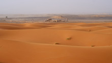 Abandoned Ruins In Sahara Desert, Landscape With A Beautiful Sand Dunes In Morocco.