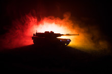 War Concept. Armored Vehicle Silhouette Fighting Scene On War Foggy Sky Background At Night. American Tank Ready To Fight.