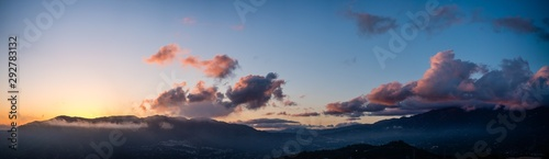 Moody cloudy sunset panorama over los angeles mountains #292783132