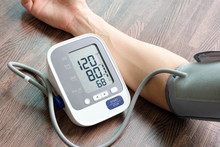Doctor Woman Check Blood Pressure Monitor And Heart Rate Monitor Pressure Gauge. Health Care And  Medical Concept