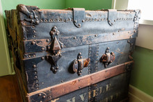Old Worn Steamer Trunk With Broken Strap, Side Closeup