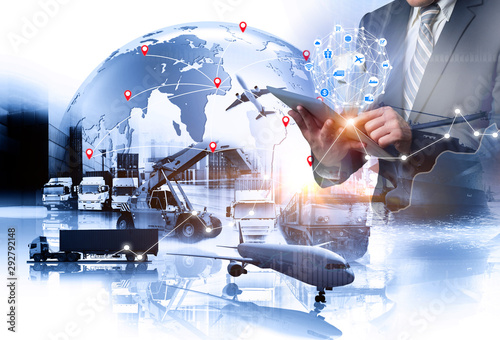 Fototapeta Multiple exposures of Businessman touching tablet for analyze stock at logistics port and world map with logistic network distribution on background, transportation trading business concept obraz