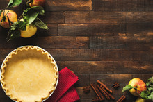 Cooking Classical American Apple Pie. Pastry Dough And Ingredients Frame On A Rustic Wooden Table Background With Copy Space. Autumn Still Life, Cooking Process