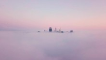 Sunrise Aerial View Of Skyscrapers In Perth Rising Above The Clouds. Dreamy Morning Above The Thick Fog Clouds With Distant Buildings Sunken In Clouds With Forward Camera Motion.
