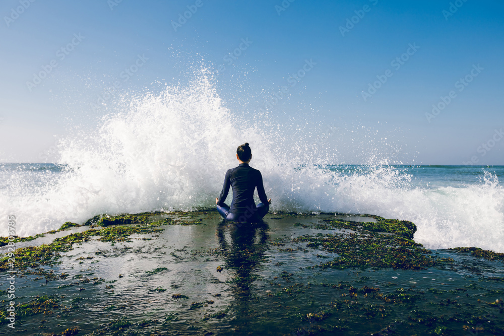 Fototapety, obrazy: Yoga woman meditation at the seaside cliff edge facing the coming strong sea waves